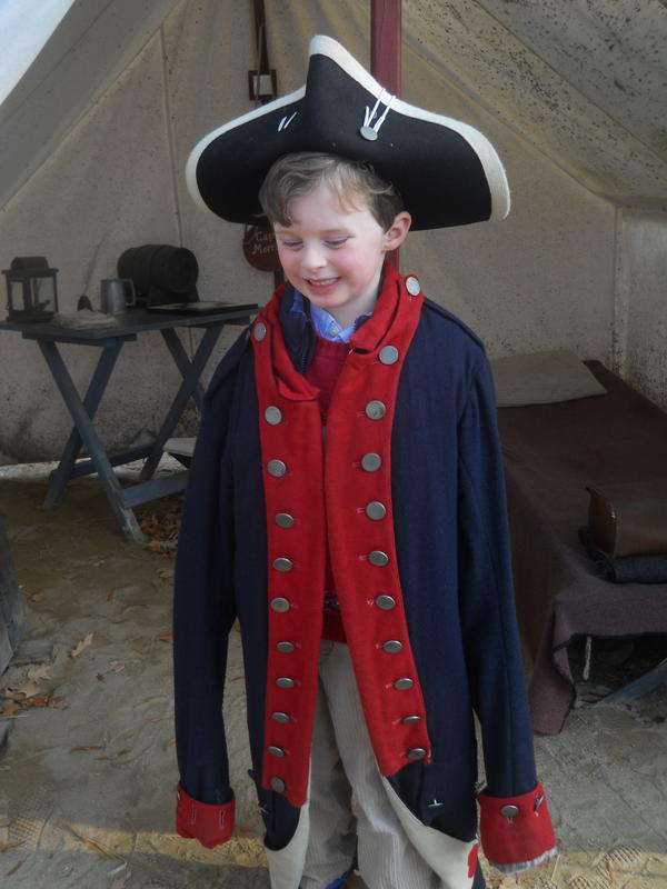 A young boy in Williamsburg soldier regalia